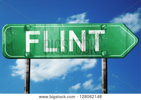 flint road sign , worn and damaged look