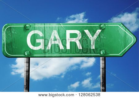 gary road sign , worn and damaged look