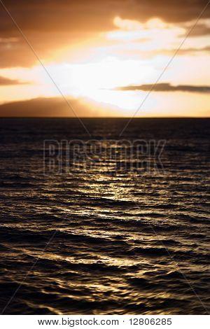 Sunset view of ocean and Kihei island in Maui, Hawaii, USA.