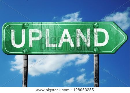 upland road sign , worn and damaged look