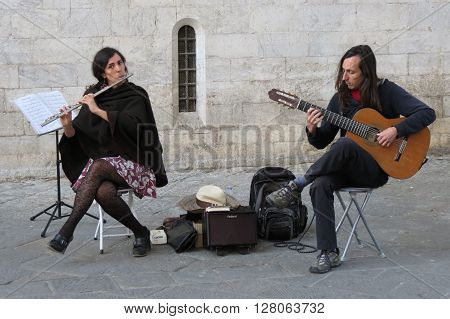SIENA ITALY - CIRCA APRIL 2016: due (traverso flute and guitar) performing on a square of the city centre