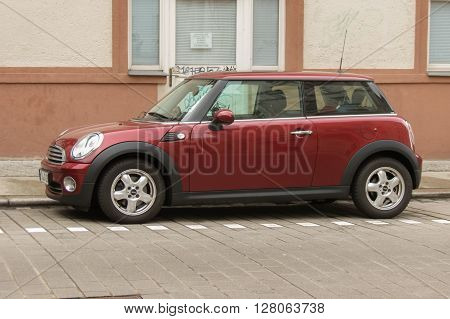 Dark Red Or Maroon Mini Cooper Car