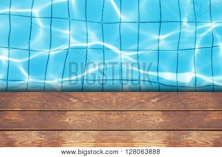 wooden deck on swimming pool reflect background