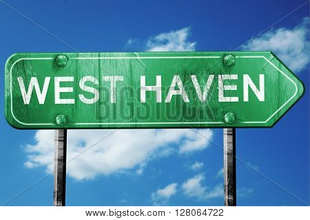 west haven road sign , worn and damaged look