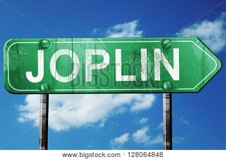 joplin road sign , worn and damaged look