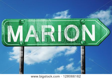 marion road sign , worn and damaged look