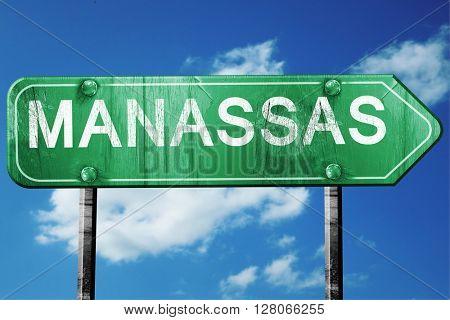 manassas road sign , worn and damaged look