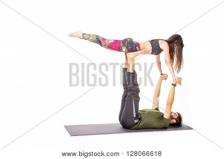 Couple in a agro yoga pose - isolated on white