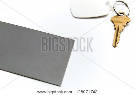 Grey Card With Key Over White