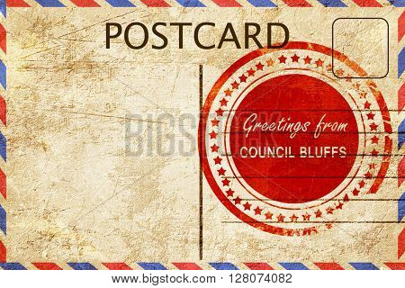 council bluffs stamp on a vintage, old postcard