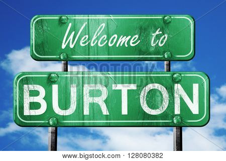 burton vintage green road sign with blue sky background