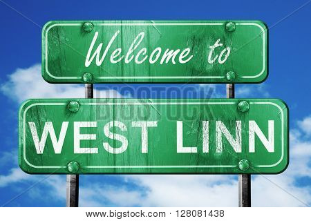 west linn vintage green road sign with blue sky background