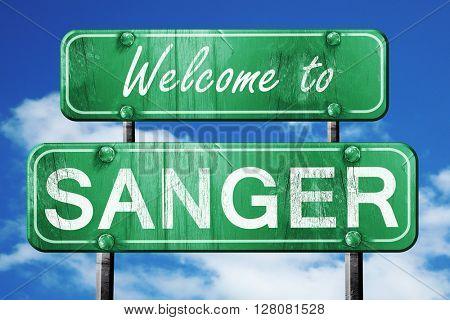 sanger vintage green road sign with blue sky background