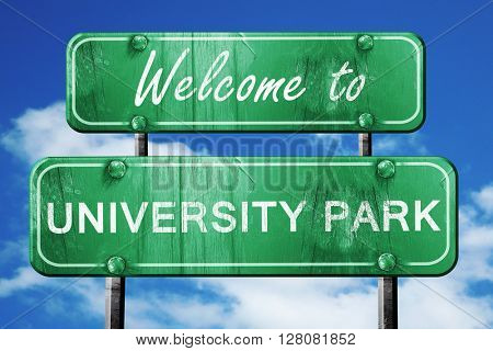 university park vintage green road sign with blue sky background