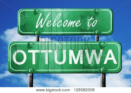 ottumwa vintage green road sign with blue sky background