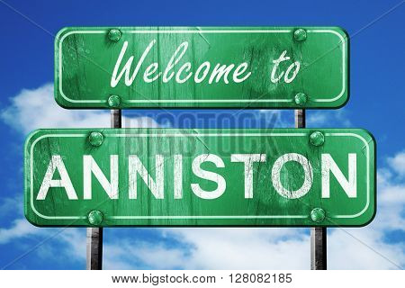 anniston vintage green road sign with blue sky background