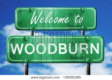 woodburn vintage green road sign with blue sky background