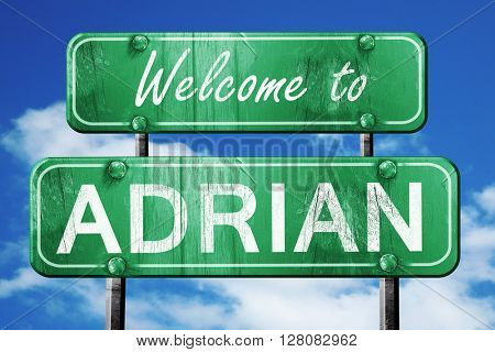 adrian vintage green road sign with blue sky background