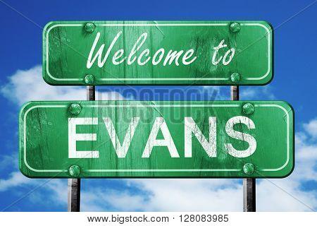 evans vintage green road sign with blue sky background