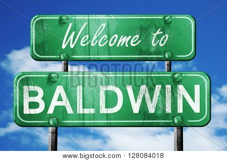 baldwin vintage green road sign with blue sky background
