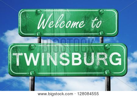 twinsburg vintage green road sign with blue sky background