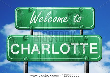charlotte vintage green road sign with blue sky background