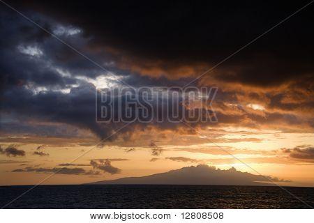 Sunset over Pacific Ocean and Kihea island in Maui, Hawaii, USA.