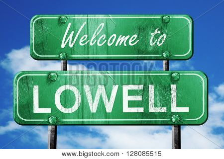 lowell vintage green road sign with blue sky background