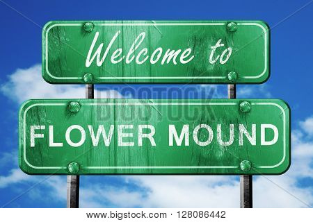 flower mound vintage green road sign with blue sky background