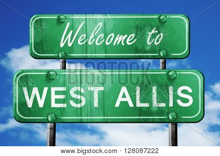 west allis vintage green road sign with blue sky background