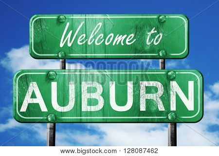 auburn vintage green road sign with blue sky background