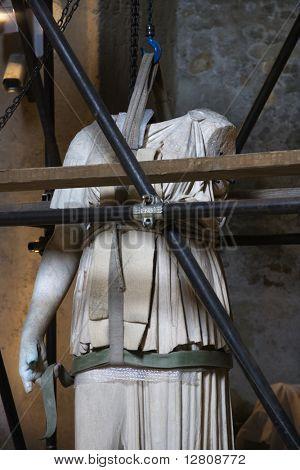 Statue under restoration in Capitolini Museum, Rome, Italy.