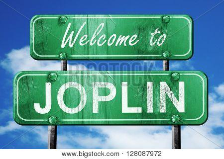 joplin vintage green road sign with blue sky background