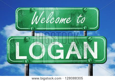 logan vintage green road sign with blue sky background