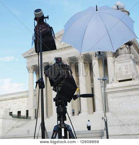 TV production set with camera and lighting equipment on tripods in front of Supreme Court building with in Washington D.C.