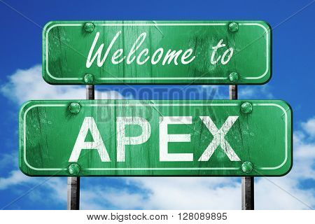 apex vintage green road sign with blue sky background