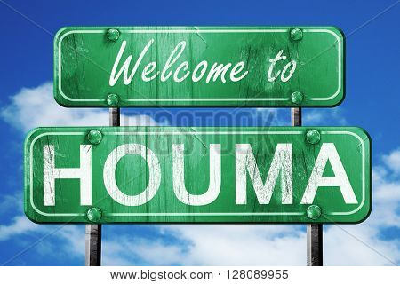 houma vintage green road sign with blue sky background