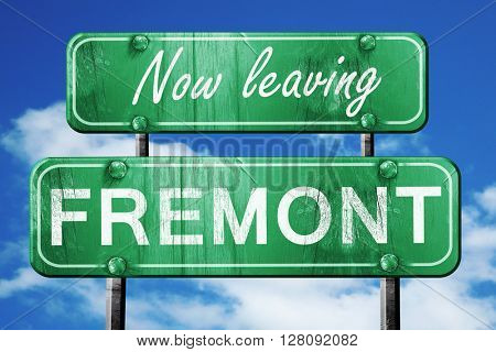 Leaving fremont, green vintage road sign with rough lettering