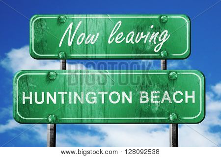 Leaving huntington beach, green vintage road sign with rough let