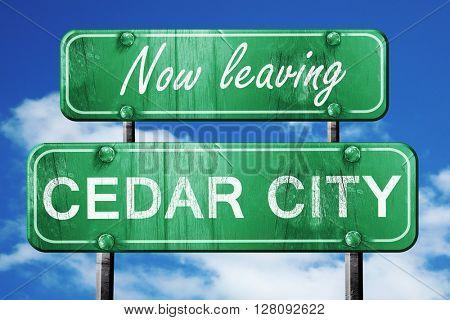Leaving cedar city, green vintage road sign with rough lettering