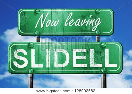 Leaving slidell, green vintage road sign with rough lettering