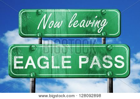 Leaving eagle pass, green vintage road sign with rough lettering