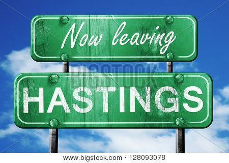 Leaving hastings, green vintage road sign with rough lettering