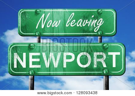 Leaving newport, green vintage road sign with rough lettering
