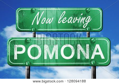 Leaving pomona, green vintage road sign with rough lettering