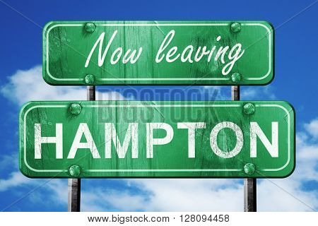 Leaving hampton, green vintage road sign with rough lettering