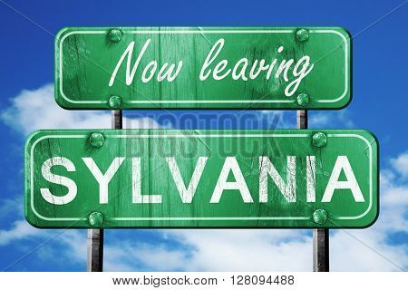 Leaving sylvania, green vintage road sign with rough lettering