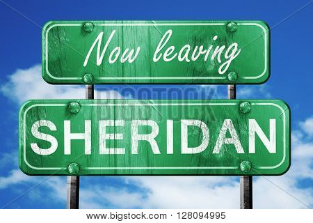 Leaving sheridan, green vintage road sign with rough lettering