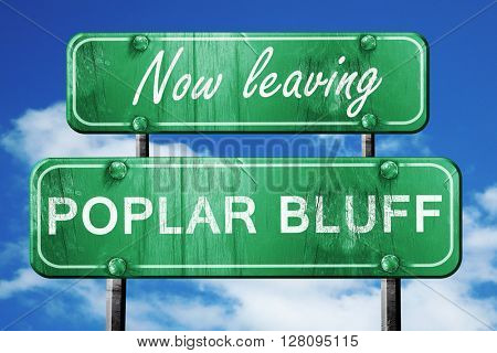 Leaving poplar bluff, green vintage road sign with rough letteri