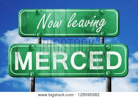 Leaving merced, green vintage road sign with rough lettering